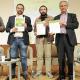 Francesc Baró, Juli Fernández, Eudald Griera i Carles Rossinyol mostrant el document signat